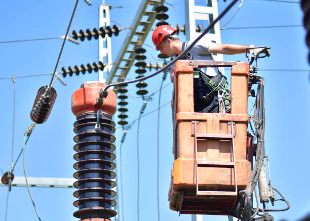 Electrician on a cherry picker repair high voltage circuit breaker Construction workers with protective workwear, hardhat and safety harness fixing power lines in electricity substation. power occupation stock pictures, royalty-free photos & images
