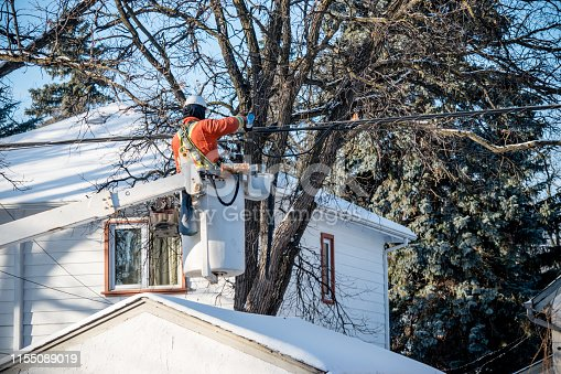 An electrician is working on the power lines