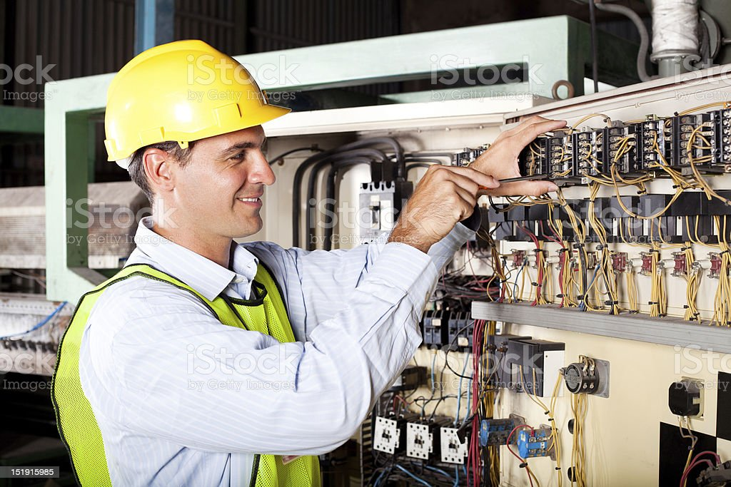 electrician reapairing industrial machine royalty-free stock photo