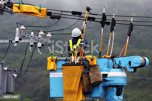 Electrician repairs a power line