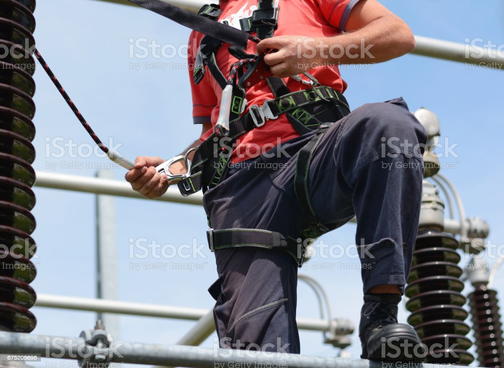 Electrician  safety harness working in Construction Harness royalty-free stock photo