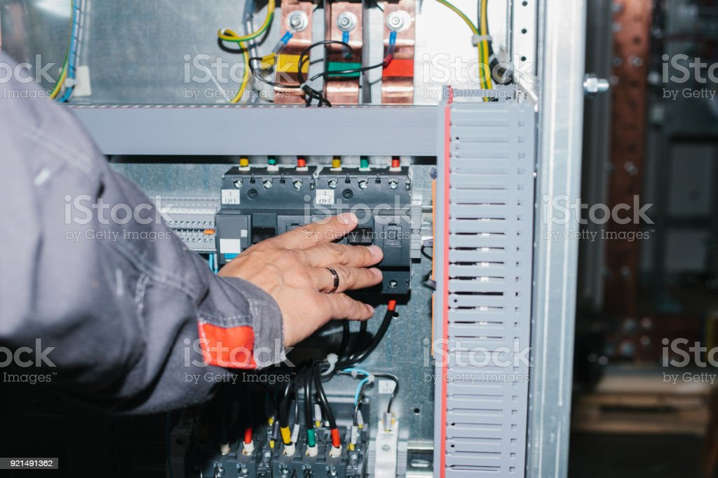 Electrician Specialist Checking Lowvoltage Cabinet Equipment Stock