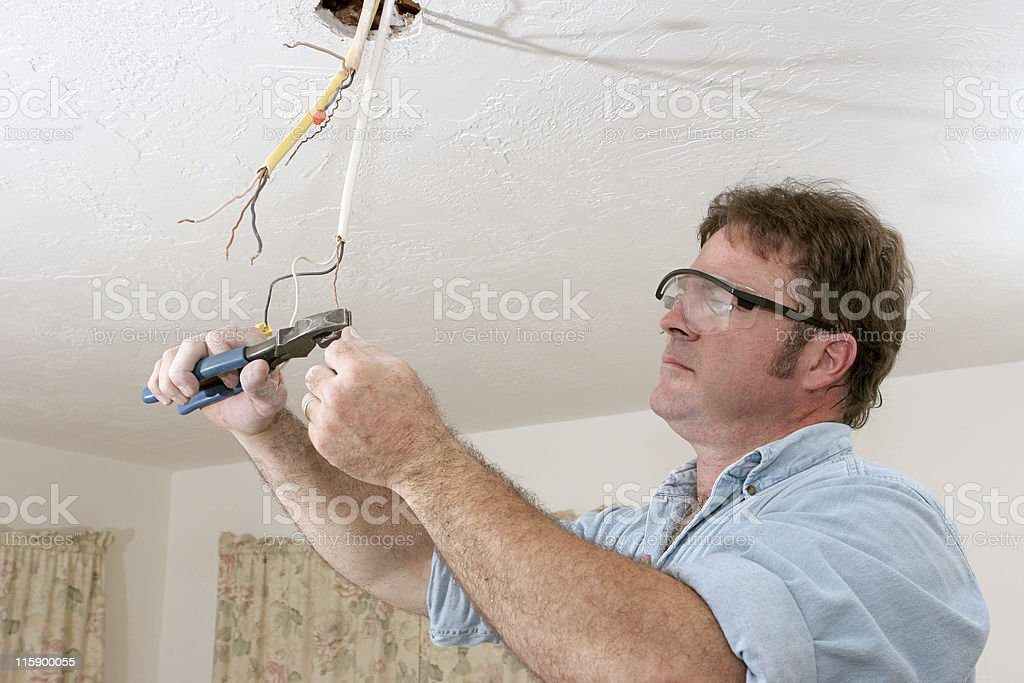 Electrician Straightents Wire royalty-free stock photo