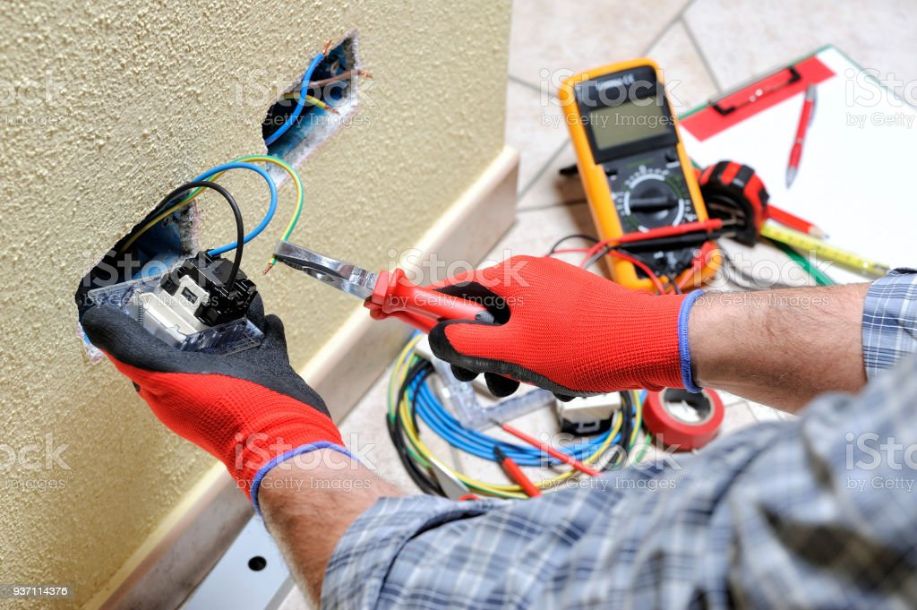 Electrician Technician At Work With Safety Equipment On A Residential Electrical System Royalty Free Stock