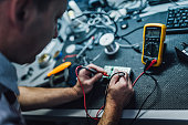 Electrician technician at workshop