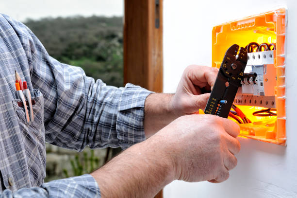 Electrician technician repairs the electrical panel of a residential system stock photo