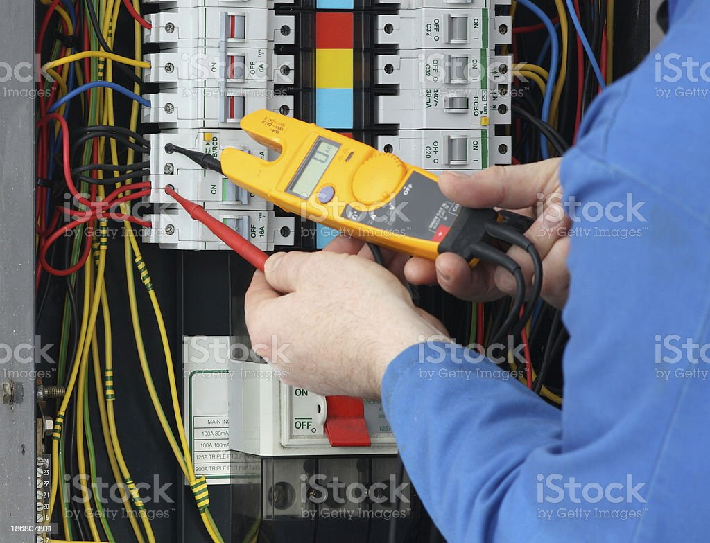 Triple Fuse Box Wiring Library 2006 Triumph Speed Diagram Electrician Testing For Voltage In A Royalty Free Stock Photo