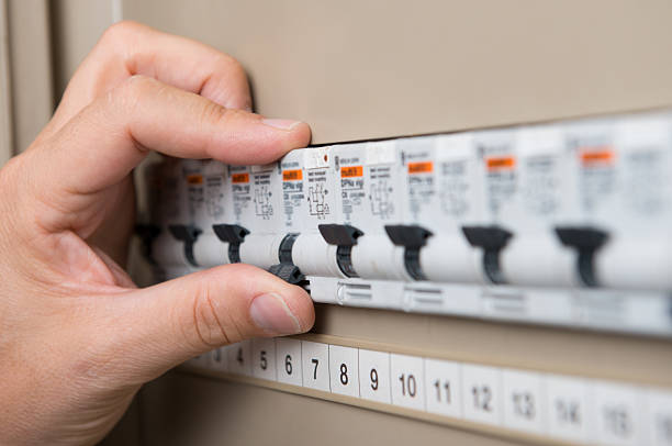 electrician testing the switchboard - fuse box stock photos and pictures