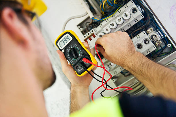 Electrician Testing Voltage A service technician is using a modern multimeter to test the Voltage . meter instrument of measurement stock pictures, royalty-free photos & images