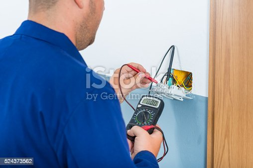 693910734 istock photo Electrician Testing Voltage 524373562
