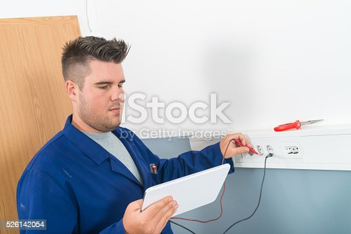 693910734 istock photo Electrician Testing Voltage 526142054