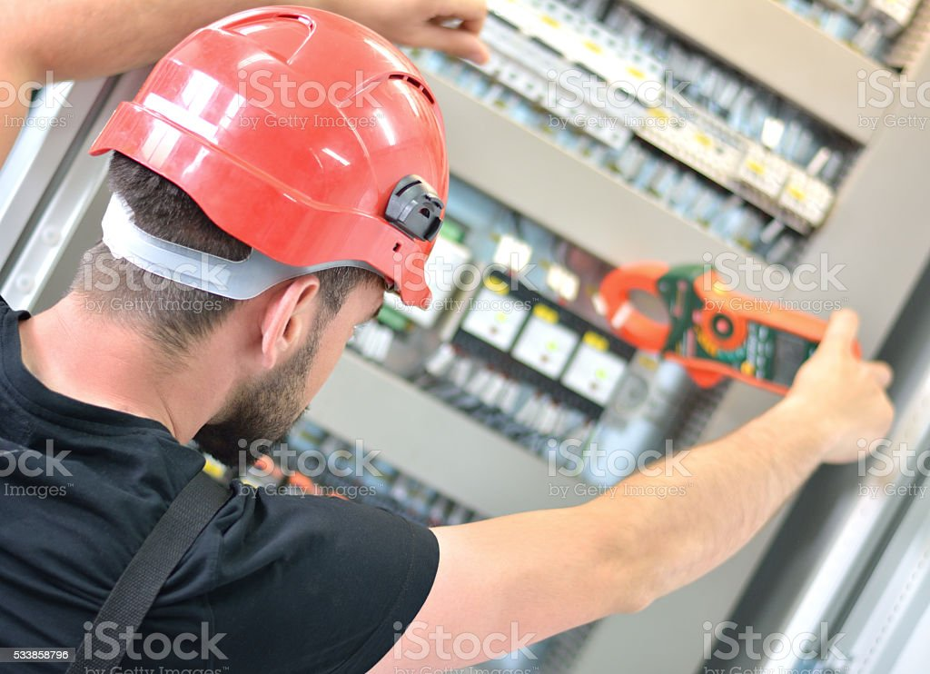 Electrician Testing Voltage with Instrument of Measurement stock photo