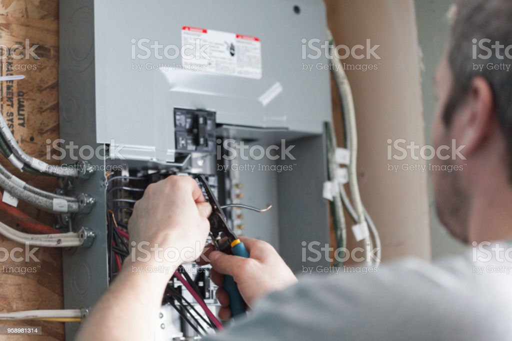 Electrician Upgrading a Homes Distribution Board stock photo