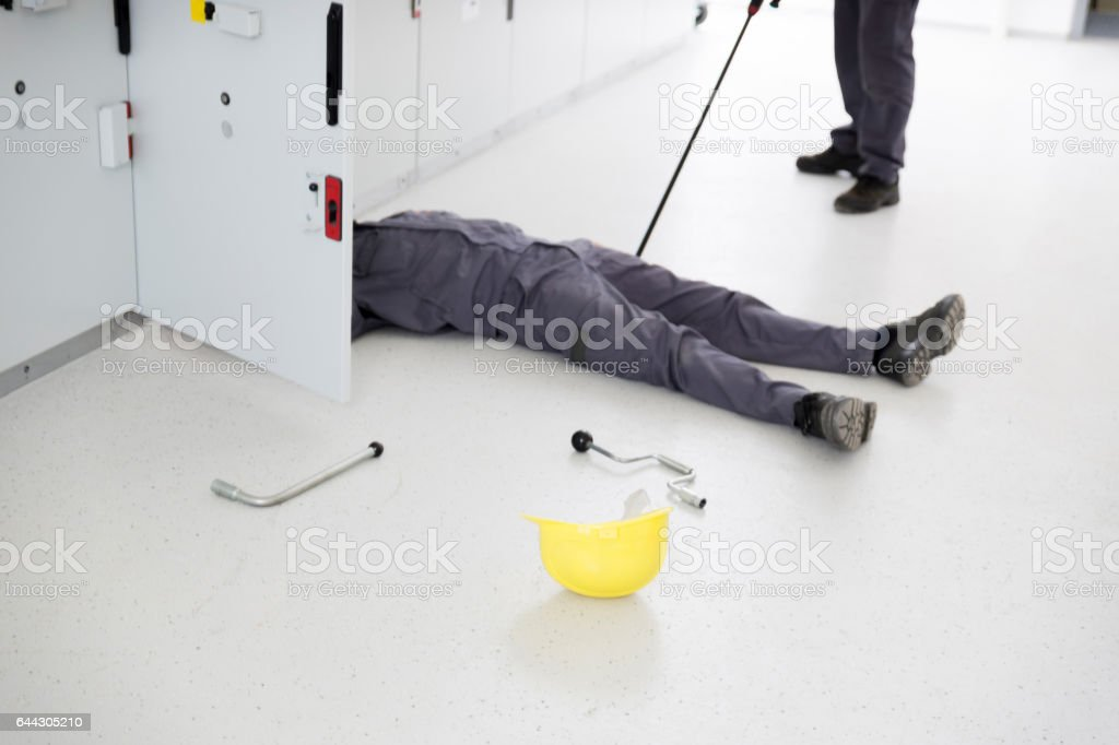 Electrician Using A Non-Conductive Extension Pole To Aid His Coleague stock photo