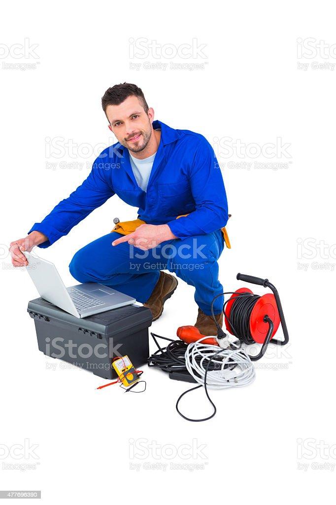 Elektriker mit laptop - Lizenzfrei 2015 Stock-Foto