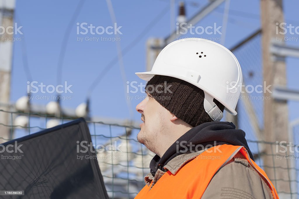 Electrician with PC royalty-free stock photo