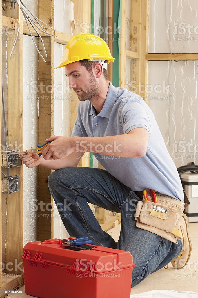 Electrician Working In A House stock photo