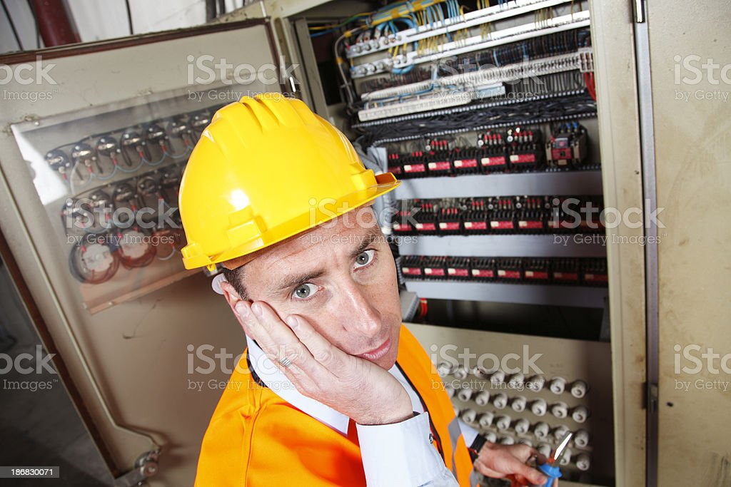 Electrician working in hard-hat royalty-free stock photo