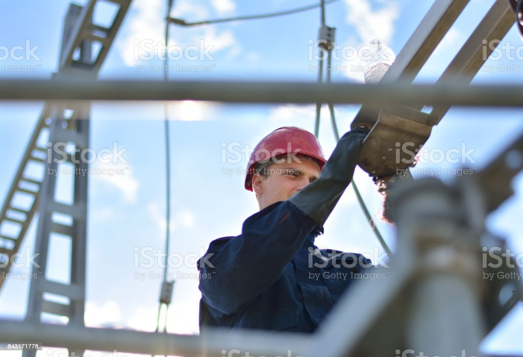 Electrician working in hight with protective equipment stock photo
