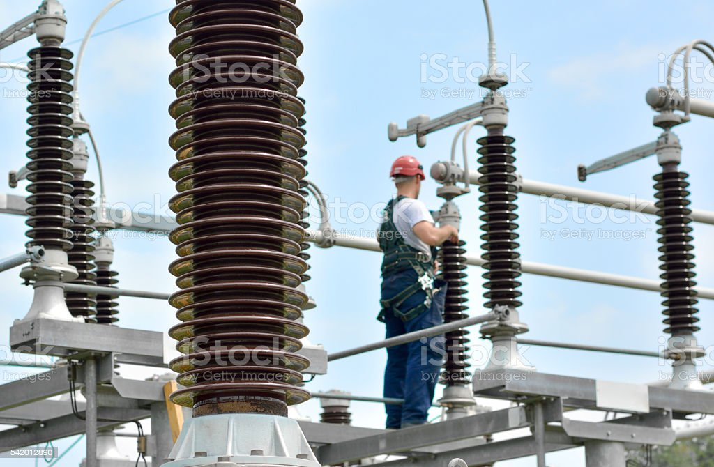 Electrician Working in Power Substation stock photo