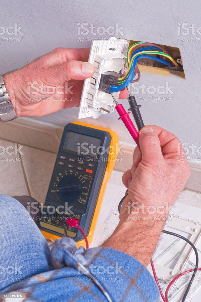 Electrician working in the electrical plant. stock photo