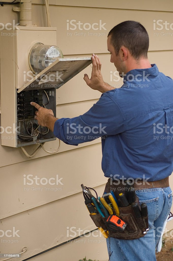 Electrician working on power box royalty-free stock photo