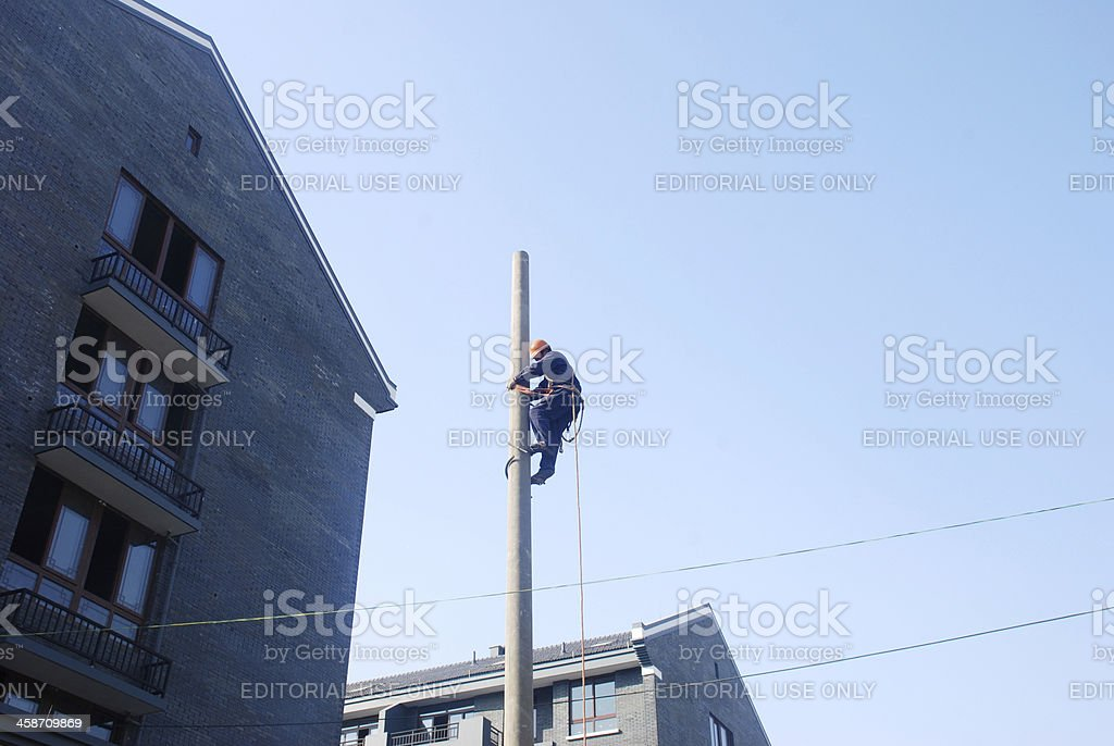 electrician working on telephone pole stock photo