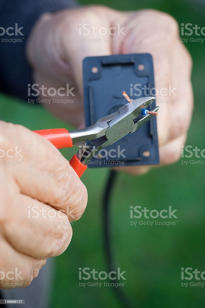 Electrician's Hands stock photo