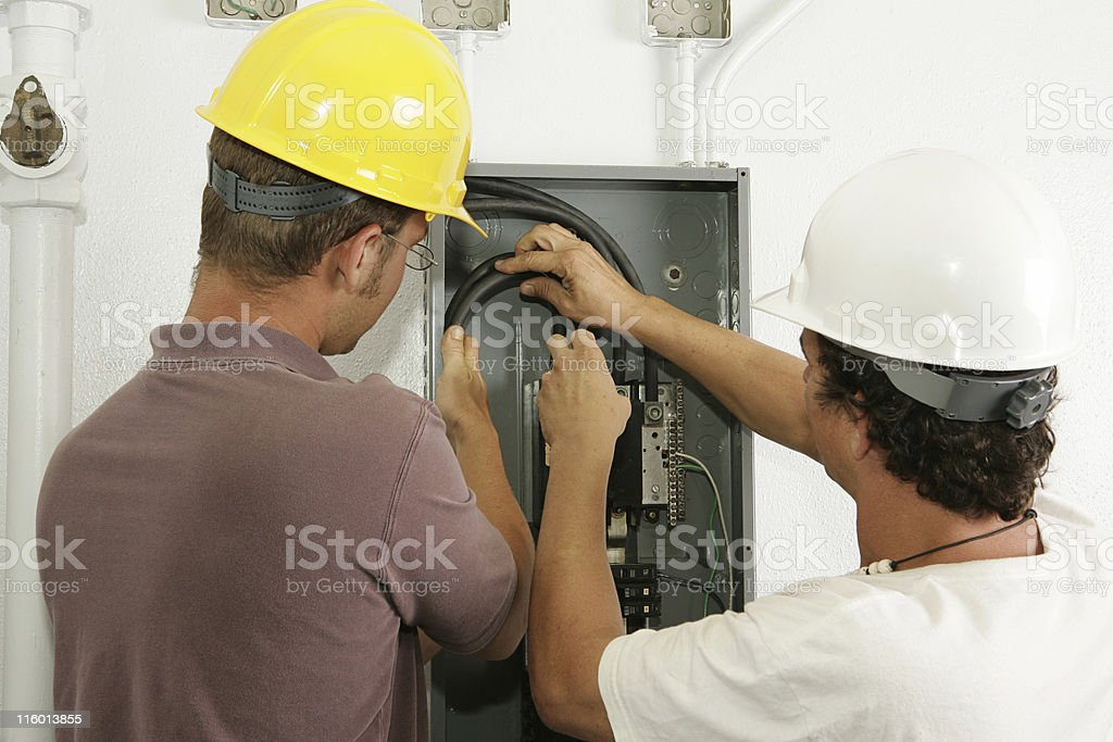 Electricians Install Panel royalty-free stock photo