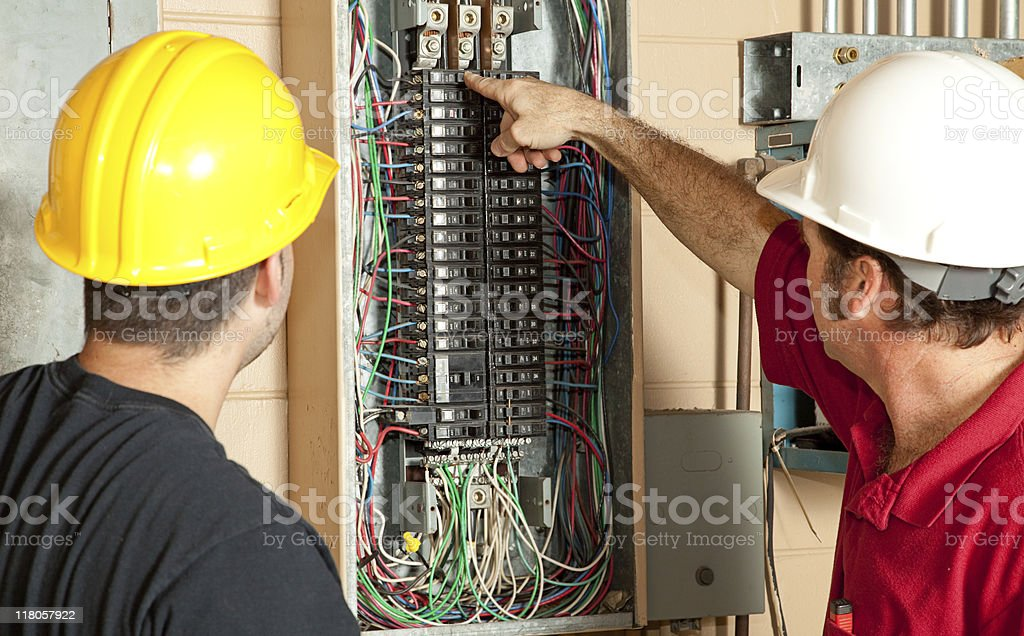 Electricians Replace 20 Amp Breaker stock photo