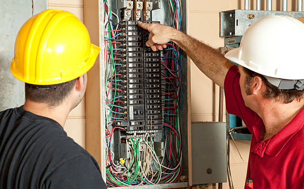 electricians replace 20 amp breaker - control panel stock photos and pictures