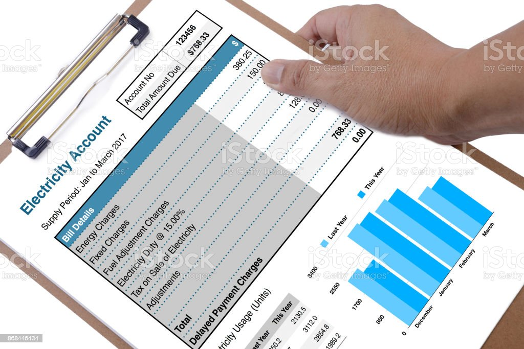 Electricity account bill in someone hand. stock photo