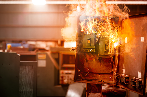 Electricity breaker overload short circuit, Old grunge messy fuse box fire burn over heat.