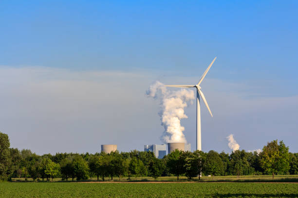 Electricity by wind power versus coal power stock photo