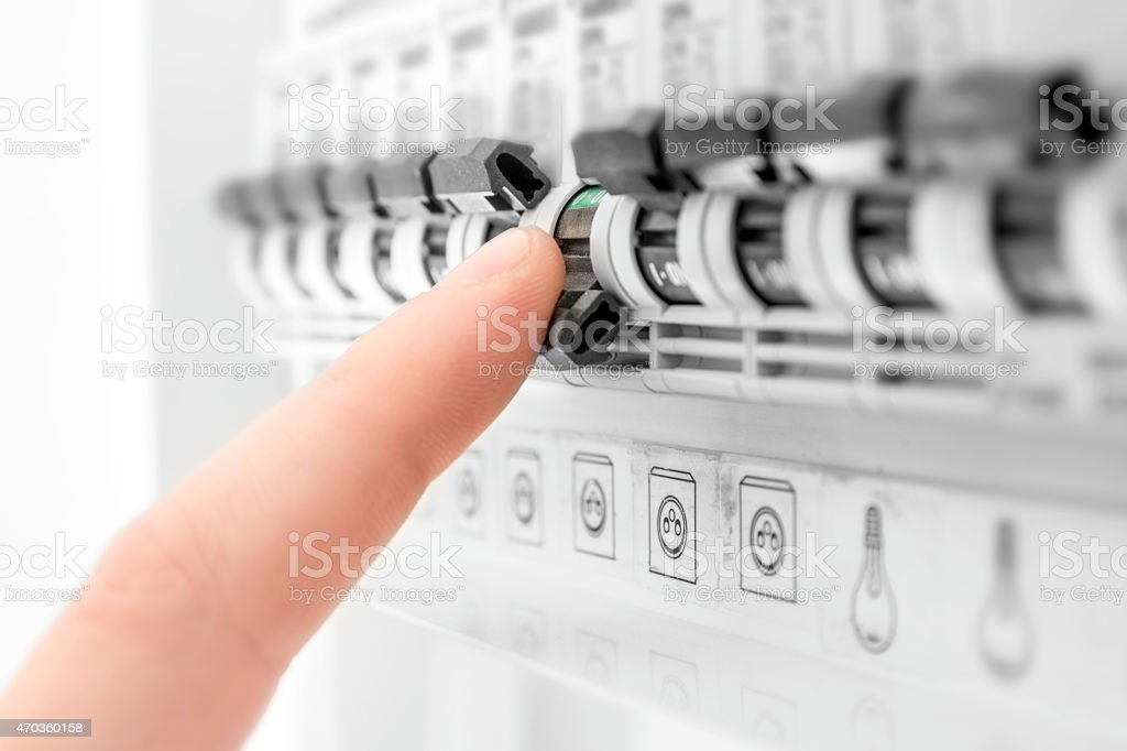 Electricity circuit breaker blown fuses human hand close-up stock photo
