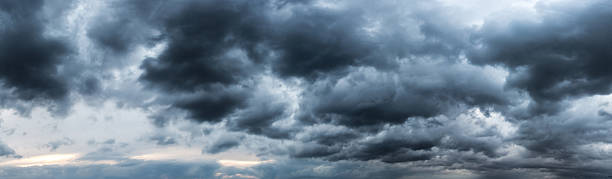 strom cloud panaroma - dramatic sky stock photos and pictures