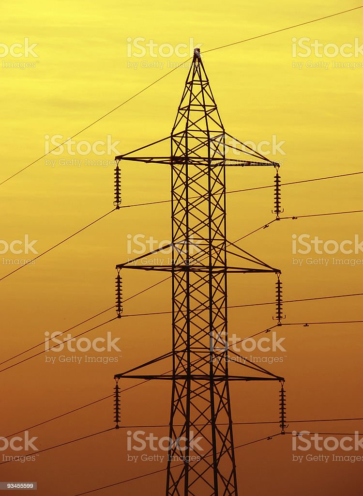 Electricity distribution tower on dusk golden background royalty-free stock photo