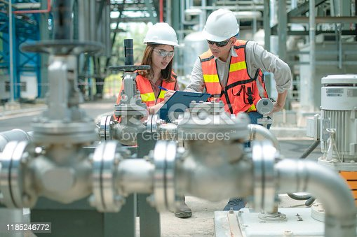 two engineer provide safety inspection as team work to ensure process problem can be solved properly