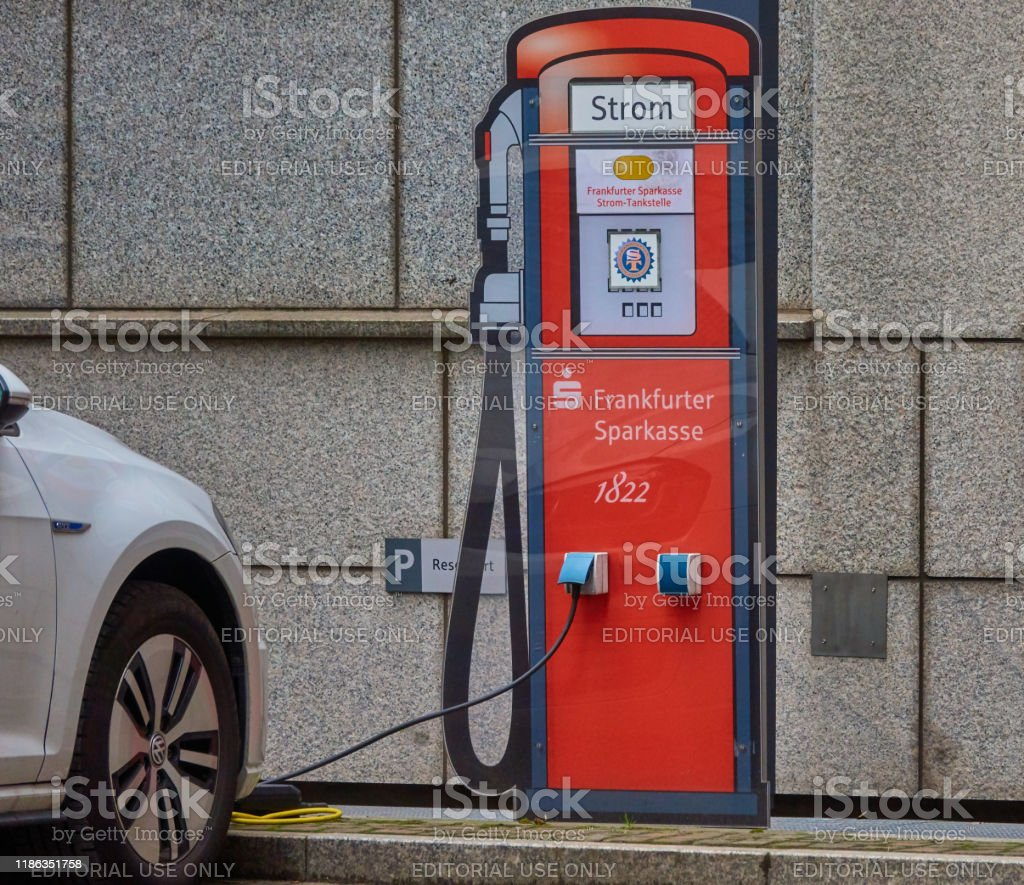 Retro Design Bank.Electricity Filling Station In Retro Design In The Parking Lot Of