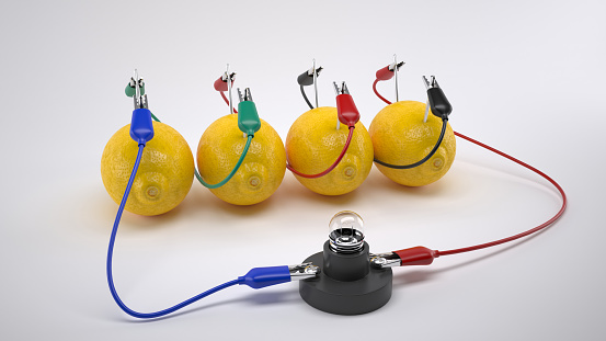 istock Electricity From Lemon battery on white background. 681013472