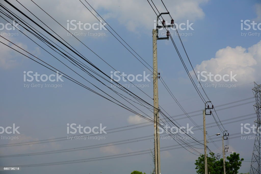 Electricity high voltage pylon and white blue sky foto de stock royalty-free