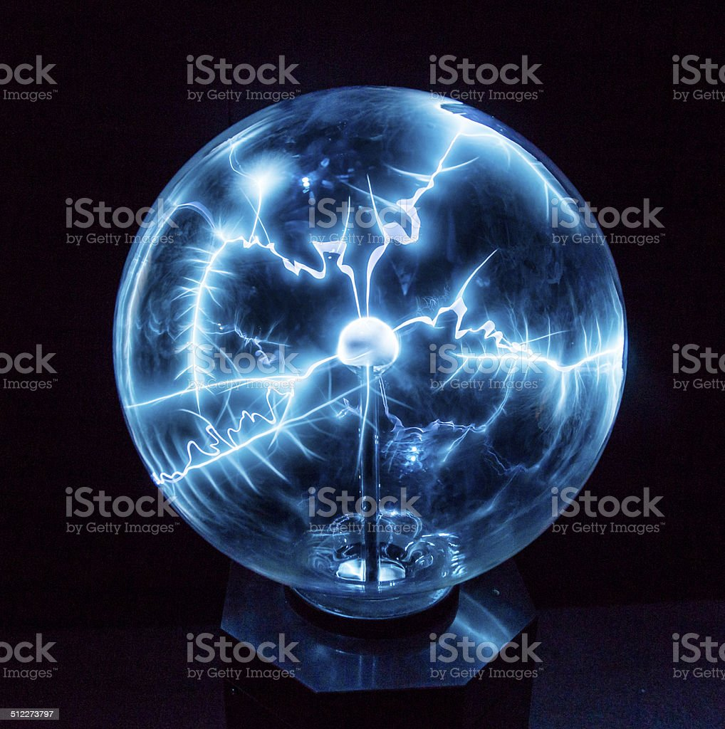 Electricity in a plasma ball stock photo