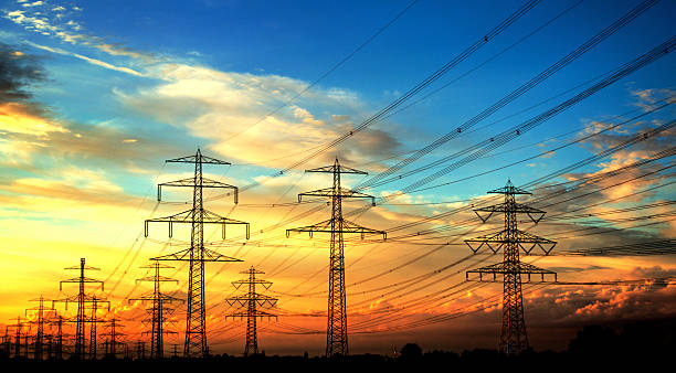 ... Electricity industry - high voltage towers in a row stock photo ...