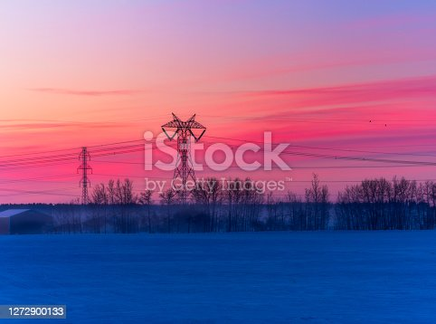 Electricity industry - high voltage towers in sunrise.