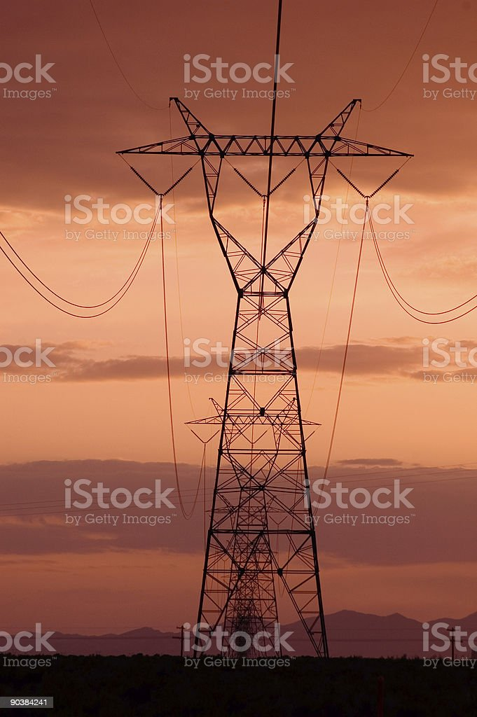 Electricity lines with sunset skies royalty-free stock photo