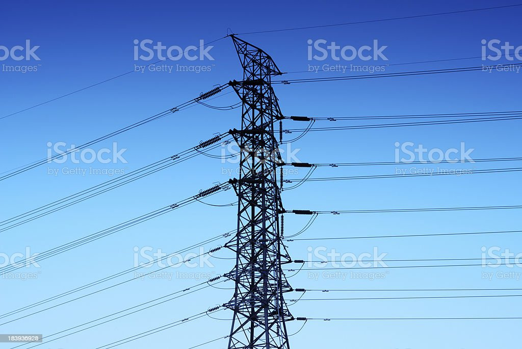 Electricity pillars against blue sky royalty-free stock photo
