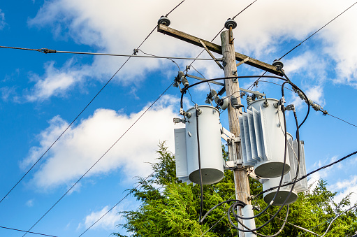 Electricity Pole with Transformers and Blue Sky
