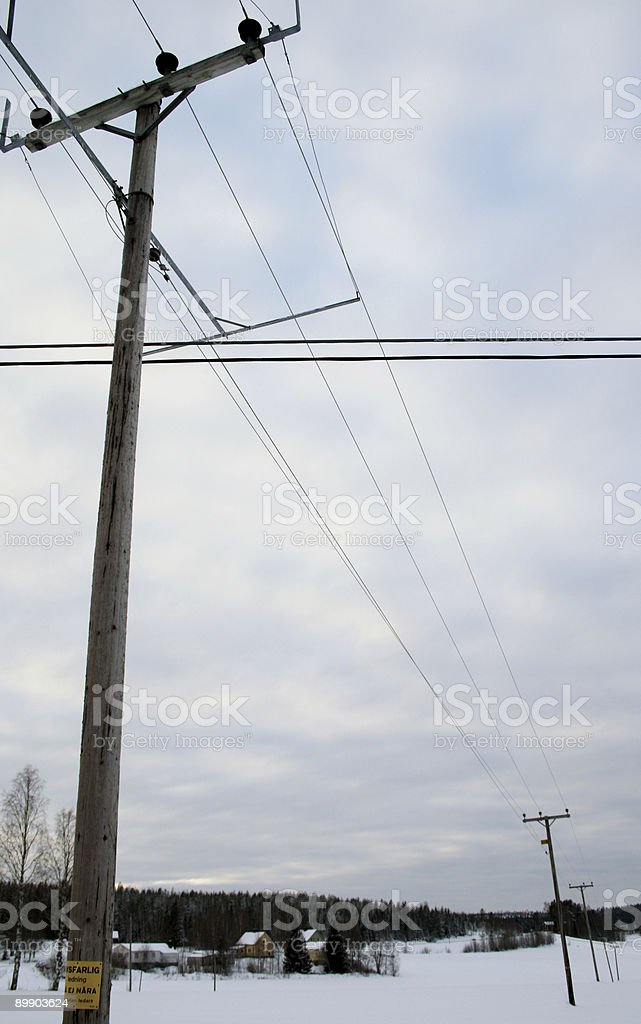 Eletricidade de postes no campo foto de stock royalty-free