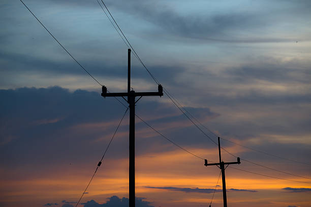 Electricity poles on colorful sky , sunset Electricity poles on colorful sky , sunset knocked down stock pictures, royalty-free photos & images