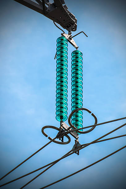 Electricity power line high coltage insulator close-up against sky stock photo